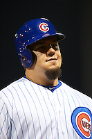 Mesa Solar Sox designated hitter Kyle Schwarber (66), of the Chicago Cubs, walks to the dugout at the end of the eighth inning after lining out to center field during a game against the Salt River Rafters on October 22, 2016 at Sloan Park in Mesa, Arizona.  It was the first game action for Schwarber who was injured April 7th and underwent surgery to repair two ligament tears in his left knee.  Salt River defeated Mesa 7-2.  (Mike Janes/Four Seam Images)
