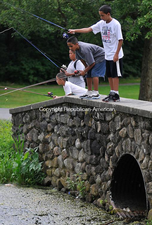 WATERBURY, CT-08 AUGUST 2010-080810IP01- (from right) Justin Ortiz, 12, and his cousins Marcus Rivera, 11, Xavior Rivera, 8, and Joshua Rivera, 13, all of Waterbury, fish at Fulton Park in Waterbury on Sunday.<br /> Irena Pastorello Republican-American
