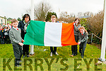 Dromclough NS principal raising the flag with the help of Eoin McElligott,Gavin O'Sullivan,Emly Moloney & Marie Quilter at the Scgool on Tuesday morning last.