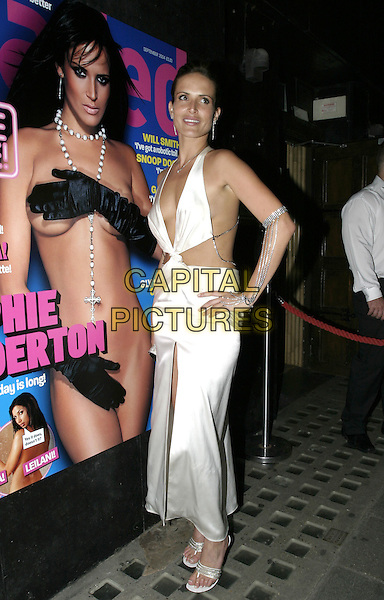 "SOPHIE ANDERTON.At Loaded Magazine's ""Summer Nude"" Edition Launch Party at Pangaea Club, Piccadilly, London,.10th August 2004..full length white stain dress backless cut away revealing plunging neckline.Ref: AH.www.capitalpictures.com.sales@capitalpictures.com.©Capital Pictures."