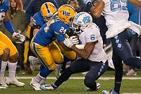 Pitt defensive back Phil Campbell (24) tackles North Carolina quarterback Brandon Harris (6). The North Carolina Tarheels defeated the Pitt Panthers football team 34-31 at Heinz Field, Pittsburgh, Pennsylvania on November 9, 2017.