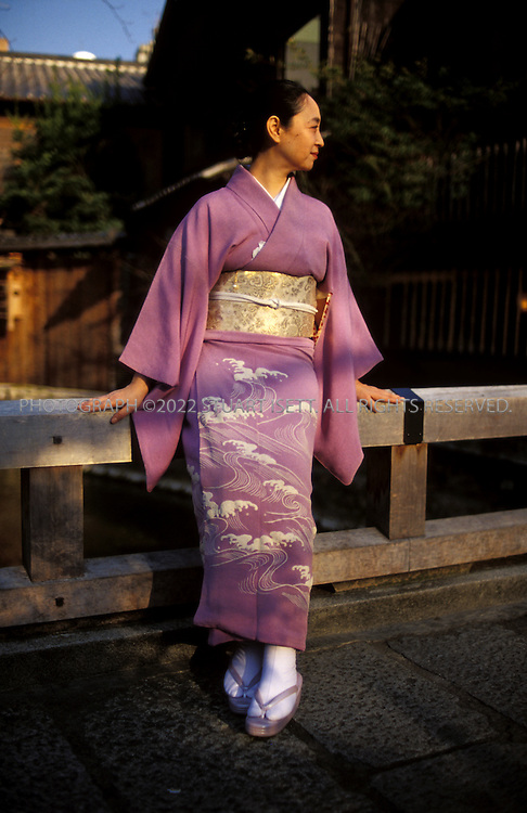 Kyoto, Japan..Mineko Iwasaki posing on a bridge in Kyoto's famous Gion geisha district...All photographs ©2003 Stuart Isett.All rights reserved.