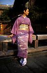 Kyoto, Japan..Mineko Iwasaki posing on a bridge in Kyoto's famous Gion geisha district...All photographs ©2003 Stuart Isett.All rights reserved.
