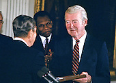 United States President Ronald Reagan awards the Presidential Medal of Freedom to actor Jimmy Stewart during a ceremony in the East Room of the White House in Washington, DC on May 23, 1985.<br /> Credit: Arnie Sachs / CNP