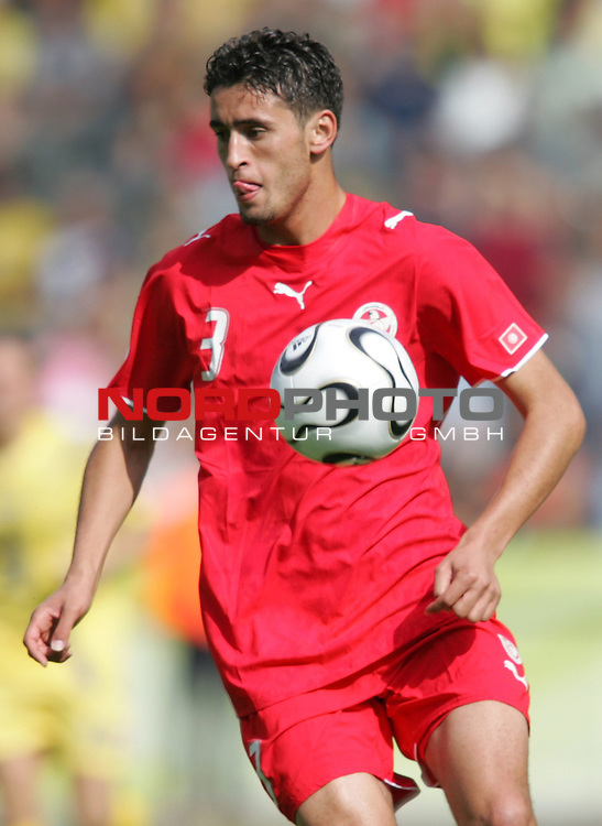 FIFA WM 2006 - Gruppe H ( Group H )<br /> Play #48 (23-Jun) - Ukraine vs Tunisia.<br /> Karim Haggui from Tunisia with the ball during the match of the World Cup in Berlin.<br /> Foto &copy; nordphoto