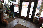 Jamie Judsen, 33, looks out the window of her small business, Constantine Auto Parts and Hardware, onto the largely empty downtown of Constantine, Michigan on December 22, 2010.  Judsen now owns the lone hardware store in town after several others went under in recent years.