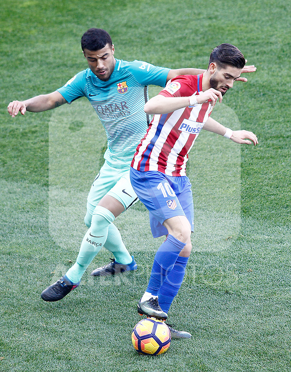 Atletico de Madrid's Yannick Ferreira Carrasco (r) and FC Barcelona's Rafinha Alcantara during La Liga match. February 26,2017. (ALTERPHOTOS/Acero)