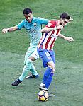 Atletico de Madrid's Yannick Ferreira Carrasco (r) and FC Barcelona's Rafinha Alcantara during La Liga match. February 26,2017. (ALTERPHOTOS/Acero)