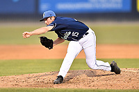 Asheville Tourists pitcher P.J. Poulin (15) delivers a pitch during a game against the West Virginia Power at McCormick Field on June 1, 2019 in Asheville, North Carolina. The  Tourists defeated the Power 16-1. (Tony Farlow/Four Seam Images)