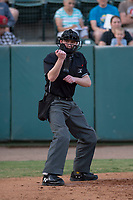 Home plate umpire Andrew Barrett calls a strike during a game California League game between the Visalia Rawhide and the Stockton Ports at Visalia Recreation Ballpark on May 8, 2018 in Visalia, California. Stockton defeated Visalia 6-2. (Zachary Lucy/Four Seam Images)