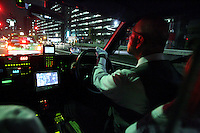 A cab driver drives his car through traffic in Tokyo, Japan, on November 3, 2006. Tokyo, seat of the Japanese government and home of the Japanese Imperial Family, is the Japanese capital, and is ranked fourth global city in the world. Photo by Lucas Schifres/Pictobank