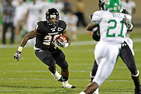 1 September 2011:  FIU running back Darriet Perry (28) carries the ball in the second half as the FIU Golden Panthers defeated the University of North Texas, 41-16, at University Park Stadium in Miami, Florida.