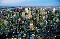 USA, New York, New York City. View of Manhattan skyline at dusk from atop of the Empire State Building