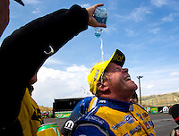 Jul. 20, 2014; Morrison, CO, USA; NHRA pro stock driver Allen Johnson celebrates as water is poured on him by teammate Jeg Coughlin Jr after winning the Mile High Nationals at Bandimere Speedway. Mandatory Credit: Mark J. Rebilas-
