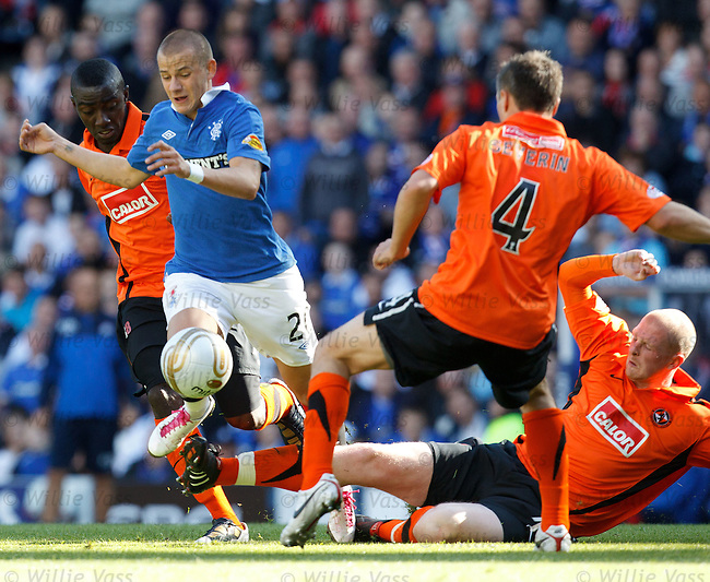 Vladimir Weiss rides three tackles on the wing as Dundee Utd dish out some heavy treatment to the Rangers man
