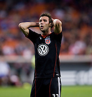 Chris Pontius (13) of D.C. United reacts to a missed chance on goal during the game at RFK Stadium in Washington, DC.  D.C. United tied FC Dallas, 0-0.