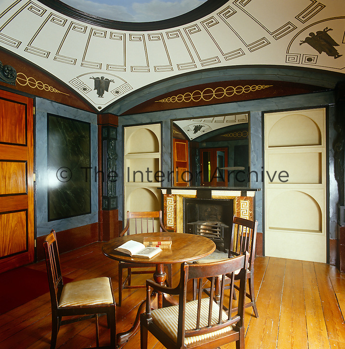 An intimate dining room in neo-classical style at Pitshanger Manor was designed by Sir John Soane in the early 1800's