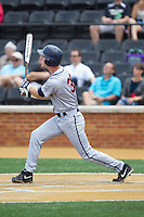 Mike Papi (38) of the Virginia Cavaliers follows through on his swing against the Wake Forest Demon Deacons at Wake Forest Baseball Park on May 17, 2014 in Winston-Salem, North Carolina.  The Demon Deacons defeated the Cavaliers 4-3.  (Brian Westerholt/Four Seam Images)