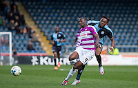 Gozie Ugwu of Wycombe Wanderers  struggles to get past Bira Dembele of Barnet during the Sky Bet League 2 match between Wycombe Wanderers and Barnet at Adams Park, High Wycombe, England on 16 April 2016. Photo by Andy Rowland.