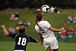 Maggie Dougher (#9), Washington State junior defender, heads the ball away from her opponent during the Cougars match with the Gonzaga Bulldogs in Pullman, Washington, on September 26, 2008.  A Mallory Fox goal in the first half held up as the Cougars shut out the Bulldogs, 1-0.