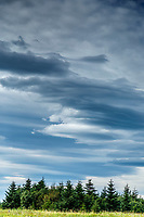 Lenticular clouds form over a coastal landsape in Lake Clark National Park Alaska.  Summer. <br /> <br /> Photo by Jeff Schultz/SchultzPhoto.com  (C) 2018  ALL RIGHTS RESERVED<br /> Amazing Views-- Into the wild photo tour 2018