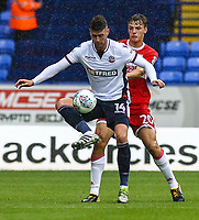 Bolton Wanderers' Gary Madine under pressure from Middlesbrough's Dael Fry<br /> <br /> Photographer Juel Miah/CameraSport<br /> <br /> The EFL Sky Bet Championship - Bolton Wanderers v Middlesbrough - Saturday 9th September 2017 - Macron Stadium - Bolton<br /> <br /> World Copyright &copy; 2017 CameraSport. All rights reserved. 43 Linden Ave. Countesthorpe. Leicester. England. LE8 5PG - Tel: +44 (0) 116 277 4147 - admin@camerasport.com - www.camerasport.com