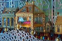 Reliquaries, including (centre) that of Saint Pierre Aumaitre, with a fragment of his femur on a pink cushion, by Cat-Berro, Orleans, with gilded glass balls, surrounded by candles and set within an aluminium valance made with Arsculpt and Technical Industrie, in the Bell tower room themed 'Le Merveilleux' or The Supernatural, first floor, in Le Tresor de la Cathedral d'Angouleme, in Angouleme Cathedral, or the Cathedrale Saint-Pierre d'Angouleme, Angouleme, Charente, France. The 12th century Romanesque cathedral was largely reworked by Paul Abadie in 1852-75. In 2008, Jean-Michel Othoniel was commissioned by DRAC Aquitaine - Limousin - Poitou-Charentes to display the Treasure of the Cathedral in some of its rooms, which opened to the public on 30th September 2016. Picture by Manuel Cohen. L'autorisation de reproduire cette oeuvre doit etre demandee aupres de l'ADAGP/Permission to reproduce this work of art must be obtained from DACS.