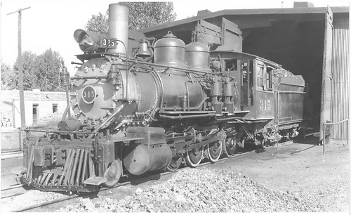3/4 fireman's-side view of D&amp;RGW #315 at Montrose engine house.<br /> D&amp;RGW  Montrose, CO  Taken by Treptow, Russell F. - 8/16/1940