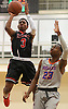 Savion Lewis #3 of Half Hollow Hills East, left, pulls up for a jumper as Gary Grant #23 of St. Raymond (Bronx) guards him during a non-league varsity boys basketball game in the Gary Charles Hoop Classic at Adelphi University on Sunday, Jan. 7, 2018. St. Raymond defeated Hills East by a score of 82-72.
