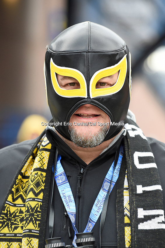 Friday January 1, 2016: A fan wears a Bruins mask on his way into Gillette Stadium for the National Hockey League Bridgestone Winter Classic game between the Montreal Canadiens and the Boston Bruins, held at Gillette Stadium in Foxborough, Massachusetts. Eric Canha/CSM