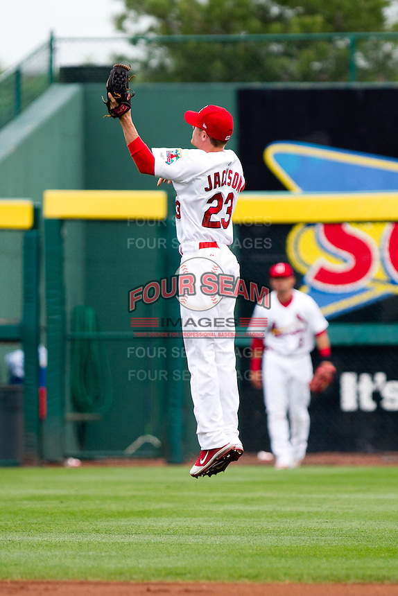 Ryan Jackson (23) of the Springfield Cardinals jumps for a ball thrown to the infield during a game against the Arkansas Travelers on May 10, 2011 at Hammons Field in Springfield, Missouri.  Photo By David Welker/Four Seam Images.