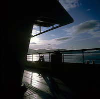 Silhouette of ships deck and railings, Norwegian fjords. Norway.