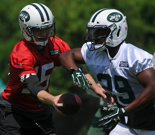Josh McCown #15, New York Jets quarterback, left, hands off to running back Bilal Powell #29 during OTAs held at the Atlantic Health Jets Training Center in Florham Park, NJ on Tuesday, May 29, 2018.