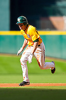 Brooks Pinckard #16 of the Baylor Bears takes off for third base against the Rice Owls at Minute Maid Park on March 6, 2011 in Houston, Texas.  Photo by Brian Westerholt / Four Seam Images