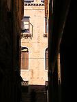 Italian buildings from dark alley