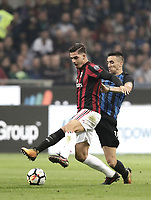 Calcio, Serie A: Milano, stadio Giuseppe Meazza, 15 ottobre 2017.<br /> Milan's Andr&eacute; Silva (l) in action with Matias Vecino (r) during the Italian Serie A football match between Inter and Milan at Giuseppe Meazza (San Siro) stadium, October15, 2017.<br /> UPDATE IMAGES PRESS/Isabella Bonotto