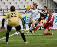Canada defender (3) Melanie Booth slides in on USA forward (9) Heather O'Reilly as she takes a shot on Canada goalkeeper (22) Erin McLeod during the Four Nations Tournament in Guangzhou, China on January 16, 2008. The United States defeated Canada 4-0.