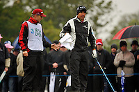Padraig Harrington hands caddy Ronan Flood a towel as he tries to keep his hands dry before starting his second 9 holes the 1st tee during Round 2 of the 3 Irish Open on 15th May 2009 (Photo by Eoin Clarke/GOLFFILE)