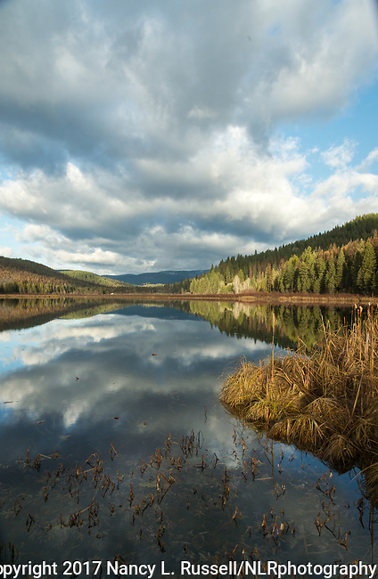 Perkins Lake in north Idaho reflecting the clouds in late fall