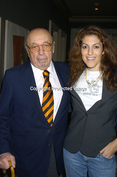 Ahmet Ertegun and Julie Greenwald ..at a Luncheon on February 8, 2005 at the Sony Club to announce the kick-off of the upcoming 30th Anniversary gala celebration of the TJ Martell Foundation in May. ..Photo by Robin Platzer, Twin Images