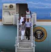 Cape Cod, MA - August 23, 2009 -- United States President Barack Obama, accompanied by his oldest daughter Malia, 11, followed by his wife Michelle and daughter Sasha, 8, disembark Air Force One after the First Family landed at Cape Cod Coast Guard Air Station on Cape Cod, Massachusetts Sunday, August 23, 2009. The First Family then boarded a US Marine helicopeter for their week-long vacation on Martha's Vineyard, Massachusetts..Credit: Vincent DeWitt - Pool via CNP