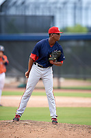 GCL Nationals relief pitcher Elvis Alvarado (43) looks in for the sign during a game against the GCL Astros on August 6, 2018 at FITTEAM Ballpark of the Palm Beaches in West Palm Beach, Florida.  GCL Astros defeated GCL Nationals 3-0.  (Mike Janes/Four Seam Images)