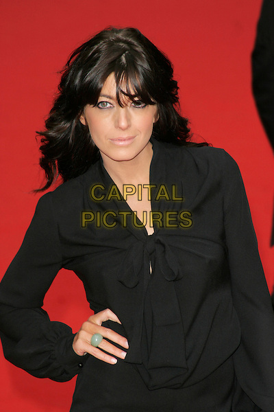 CLAUDIA WINKLEMAN.Red Carpet Arrivals for the British Academy Television Awards 2008, held at the London Palladium, London, England, .April 20th 2008. .BAFTA BAFTA's half length black hand on hip blouse shirt top bow tied.CAP/AH.©Adam Houghton/Capital Pictures.