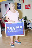 Claribel Biba-Ferrer, 76, of Hialeah, picks up campaign signs and stickers at the Donald Trump campaign office in Hialeah, Miami, Florida, on Sun., Oct. 9, 2016.
