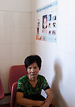 A patient sits in the waiting room at Preah Ang Duong Hospital, in Phnom Penh, Cambodia.