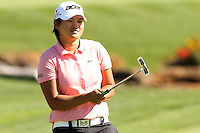 Yani Tseng reacts after missing her putt on the 18th green at the 5th Annual Notah Begay III Foundation Challenge at Atunyote Golf Club in Vernon, New York on August 29, 2012