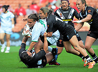 Billy-Jean Ale is tackled during the Women's Rugby League World Cup warmup match between the Kiwi Ferns and Wahine Toa at the FMG Stadium in Hamilton, New Zealand on Saturday, 4 November 2017. Photo: Dave Lintott / lintottphoto.co.nz