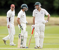 Ben Scott (L) and George Adair of Hampstead in discussion during the ECB Middlesex Premier League game between North Middlesex and Hampstead at Park Road, Crouch End on Saturday May 17, 2014
