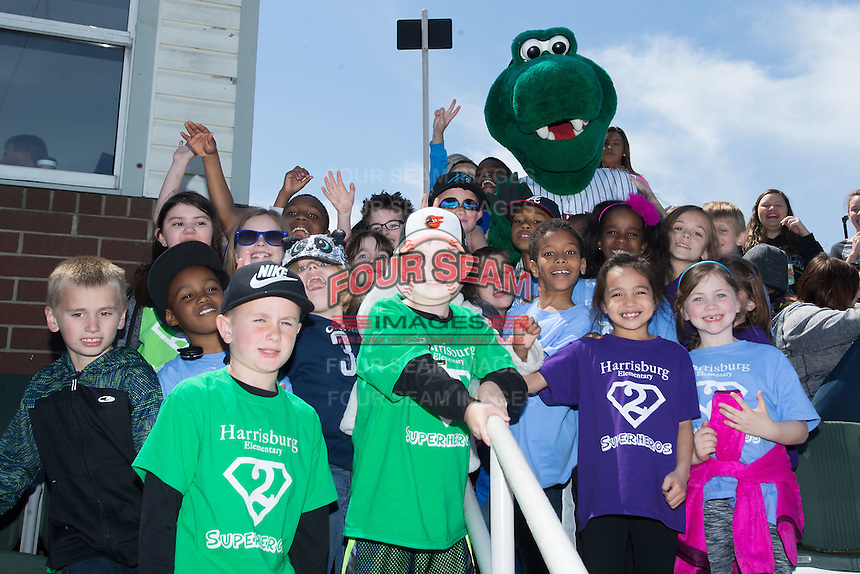 Kannapolis Intimidators mascot Tim E. Gator is surrounded by some of the students on hand for Education Day at Kannapolis Intimidators Stadium on April 13, 2016 in Kannapolis, North Carolina.  The Intimidators defeated the Shorebirds 8-7.  (Brian Westerholt/Four Seam Images)