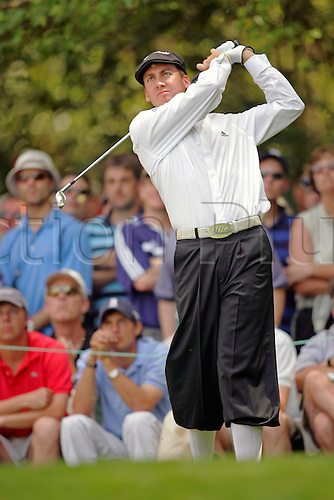 6 April 2005: British golfer Ian Poulter plays an iron during the Par 3 Contest of the Masters Tournament held at the Augusta National Golf Club, Atlanta, Georgia. Photo: Actionplus..050406 plus-fours